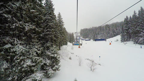 POV perspective of empty chairlifts at ski area Footage