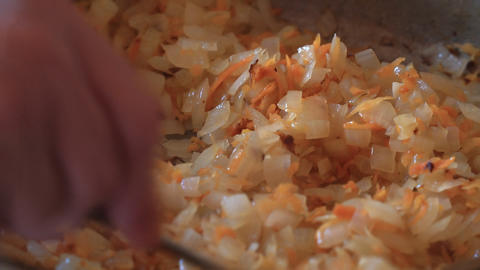 Cabbage with vegetables is fried in a frying pan Footage