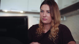 Beautiful young woman working behind a mobile computer. Home style Footage
