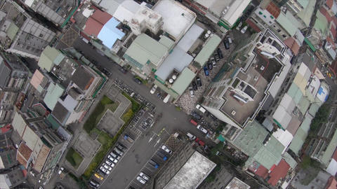 Aerial drone shot above busy street of Taipei, Taiwan Live Action