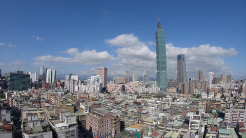 Aerial drone shot above the city of Taipei, Taiwan in a clear sky Live Action