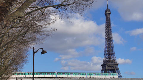 Subway crossing the Seine in Paris with the Eiffel Tower in background Footage