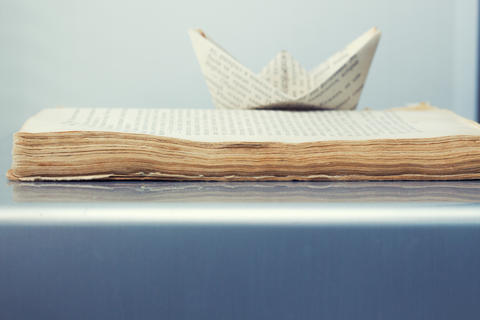 old book and paper ship of words Photo