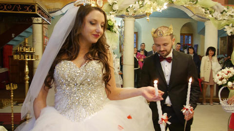 Bride and groom walking in circle in orthodox church during wedding ritual after Footage