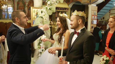 Wedding ritual with best man, bride and groom in a church Live Action