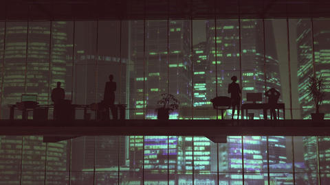 Silhouettes In An Office Building Against Of Skyscrapers GIF