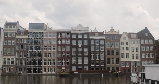 Archetypal apartments along a canal in Amsterdam Footage
