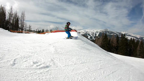 Freestyle skiing. Little boy jumping in a snowpark Footage