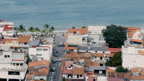 Pan of the ocean and beach above the old historic city of Puerto Vallarta Mexico Footage