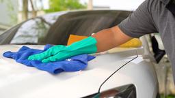 Man worker polishing car on a car wash GIF