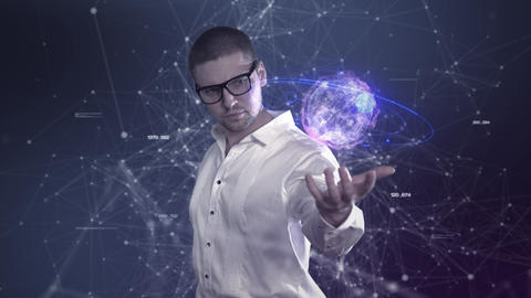 A male scientist in a white shirt holds an abstract ball in his hands against a Image