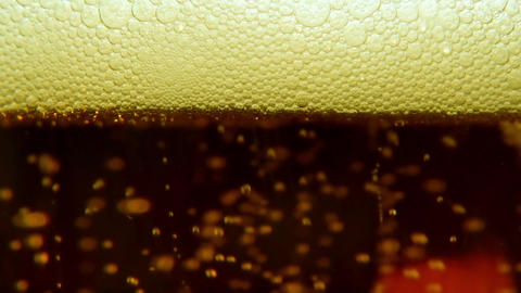 Macro plan of beer with bubbles Footage