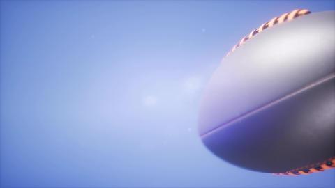 4K Super slow motion flying football on blue sky background Footage
