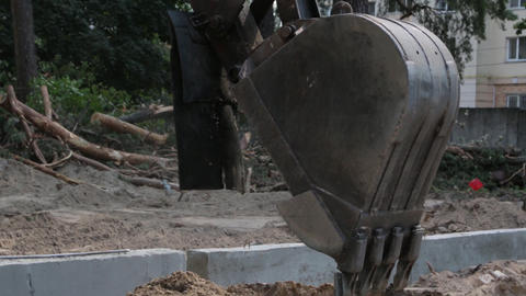 Excavator Bucket Digs the Earth Footage