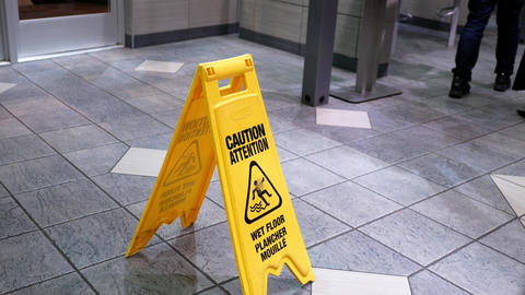 Sign showing warning of caution wet floor at Mcdonalds restaurant with 4k Footage