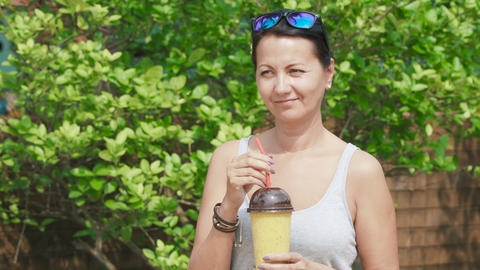 woman drinks a cold drink Stock Video Footage