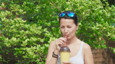 woman drinks a cold drink Footage