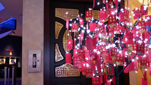 Motion full of red envelopes on tree to celebrate Chinese new year in Casino Footage