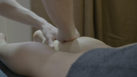 Close up of a good looking woman getting a legs massage at the spa from a male Footage