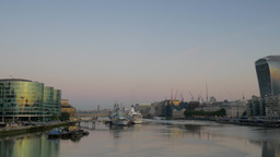 A pan across the River Thames at sunrise from the Shard to the City of London. T Footage