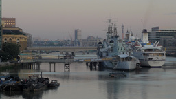 The warship and museum HMS Belfast with the German cruise liner Berlin moored al Footage