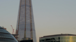 Tilt shot down the Shard London from the top to City Hall and the River Thames.  Footage