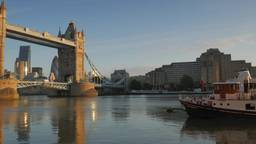 Pan From A Thames River Boat To Tower Bridge And The World Trade Centre. Taken O stock footage