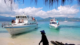 Hopping boats are arriving to Gili Air Island,Indonesia Footage