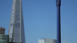 Tilt down the Shard in London to HMS Belfast taken from the north bank of the Th Footage