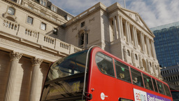 Tilt up from a red London bus to the Bank of England. Shot in 4K on a sunny autu Footage