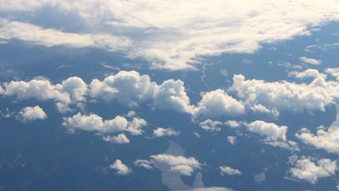 Broken clouds under wing of airplane Footage