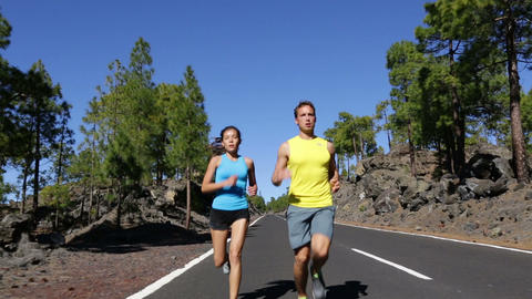 Running couple jogging on road healthy lifestyle Live Action
