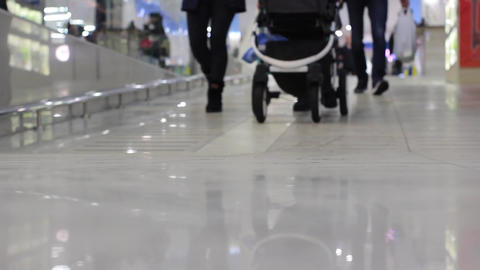 Unrecognizeble people with baby carriage in a mall Footage