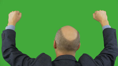 Man rising and moving fists up isolated on green background. Alpha channel Image