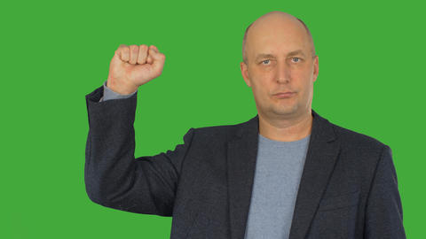 Man showing clenched fist up on right hand on green chroma key background. Alpha Footage