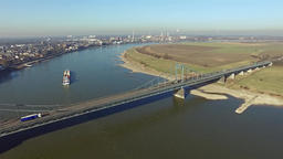 Krefeld, Germany - February 15, 2017 : Container ship passing the bridge between Footage