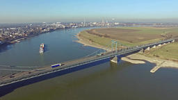 Container ship passing the bridge between Krefeld and Duisburg aerial time lapse Footage