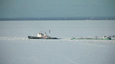 Icebreaker goes through ice field Footage