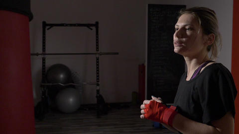 Profile of beautiful attractive blonde woman boxing in a gym to stay fit in slow Footage