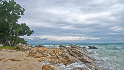 Tropical landscapes, trees, rocks and waves Stock Video Footage