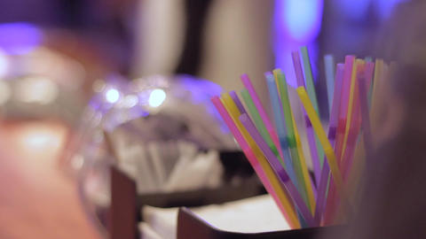 Plastic colored cocktail straws at bar Live Action