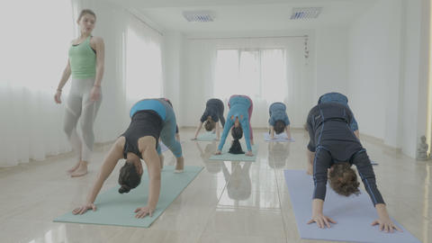 Group of middle aged women working out while exercising warrior pose during a Footage