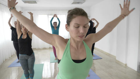 Middle aged housewives woman doing yoga poses in slow motion inside a wellness Footage