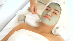 Face peeling mask, spa beauty treatment, skincare. Woman getting facial care by Filmmaterial