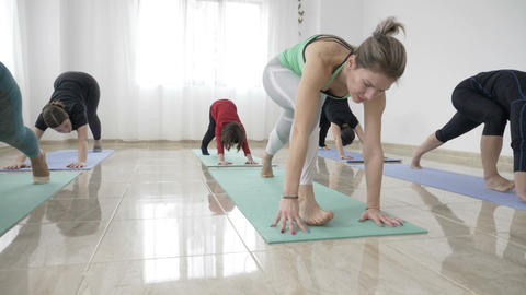 Single middle aged woman mother taking her little daughter to a yoga class to Footage