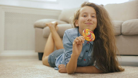 Beautiful fair-haired teen girl with Candy Footage