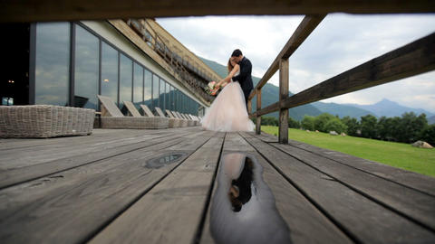 Romantic photosession of the newlyweds. Reflection in a puddle Footage