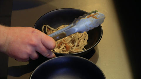 Chef put the udon noodles into a bowl Footage