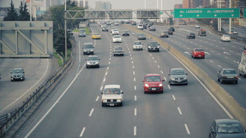 Yellow taxi cab in Highway Traffic Downtown Stock Video Footage