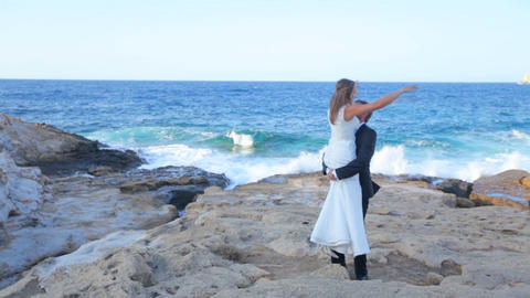 Bride and groom on the seashore on their wedding day Footage